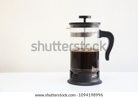 A classic French press in a isolated background, coffee