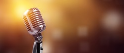 A classic musical microphone on blur colorful background