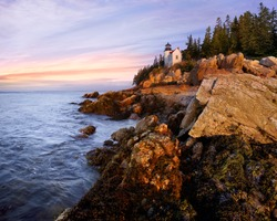 A Classic New England Lighthouse, The Bass Harbor Head Light In The First Light Of Dawn, Acadia National Park, Maine, USA