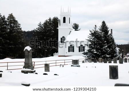 A classic white church is set against white snow #1239304210