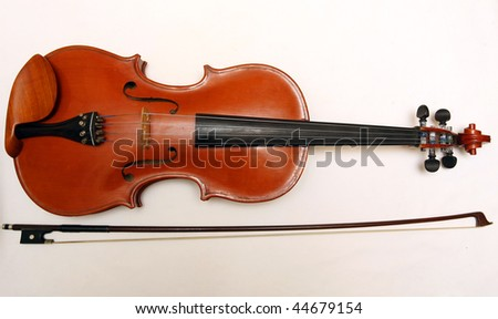 a classical violin and bow on a white background