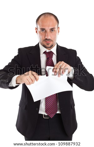 a classy businessman tearing some paper sheets - stock photo