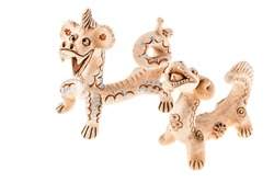 a clay terracotta funny dragon character isolated over a white background