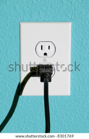 A clean image of a 110 volt wall power outlet against a freshly painted wall.  Perfect image for any abstract energy promotion use or to make inferences for home design or appliance use.