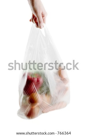 A clear plastic grocery bag filled with vegetables, a healthy choice
