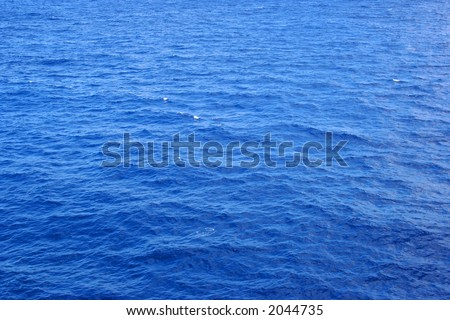 A clear shot of wide open ocean water. Great background picture.