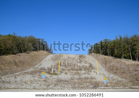 A clearing in the forest for the gas pipeline. Underground gas pipeline.