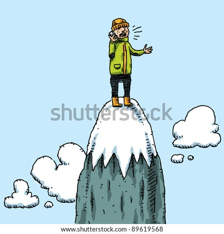 A climber takes a mobile phone call on top of a mountain. - stock photo