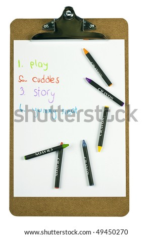A clipboard holding paper with a childs to-do list written with colorful crayons - stock photo