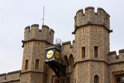 A Clock Adorning the Tower of London, Officially Her Majesty's Royal Palace and Fortress of the Tower of London, is a Historic Castle Located on the North Bank of the River Thames.