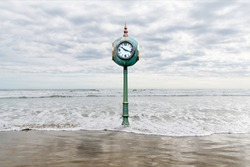 A clock in rising sea waters depicting the metaphors of time and change