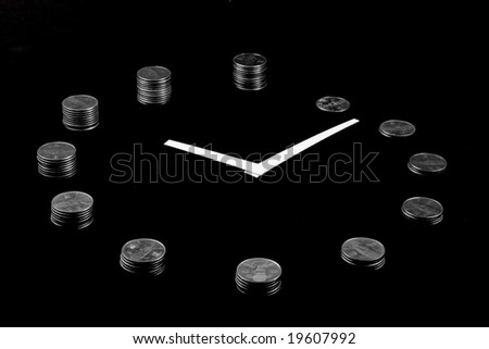 A clock on black background made from silver coin towers showing concept of earning money as time goes
