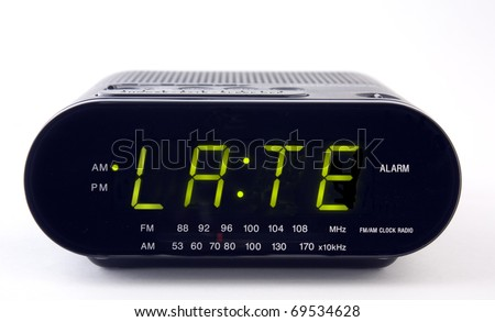 A Clock radio with the word LATE