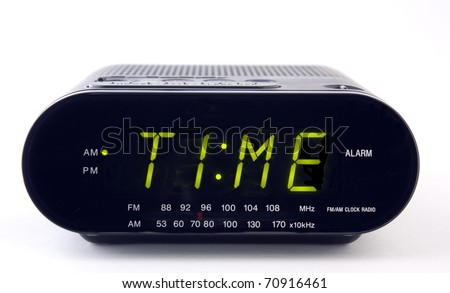 A Clock radio with the word TIME