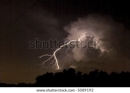 A close strike of lightning on a warm summer night - stock photo