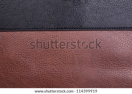 A close up background texture of brown and black leather.