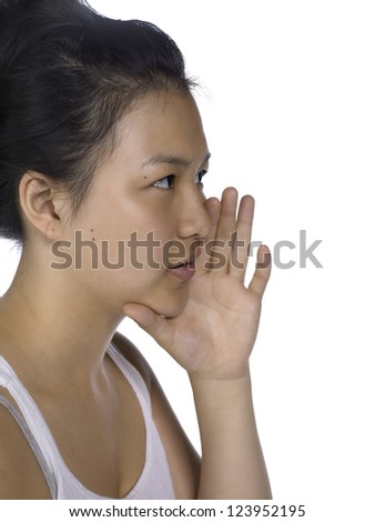 A close-up cropped image of a lady on a whispering gesture over the white background