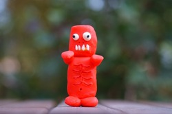 A close-up figure of a red zombie. Halloween decorations. Zombie apocalypse. Funny monsters.
