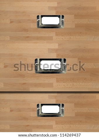 A close up image of a metal cabinet label - stock photo