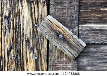 A close up image of an old wooden door latch.  - Shutterstock ID 1174233868