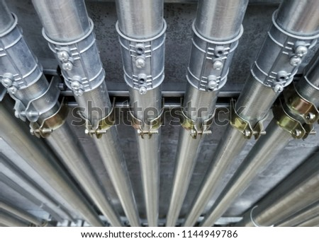 A close up image of electrical metallic tubing in the building. Stock photo ©