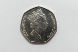 A close up macro image of the Obverse side of a British 50p coin issued in 1994 showing a detailed portrait of Queen Elizabeth II.