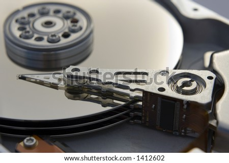 A close up macro of an opened computer harddrive.