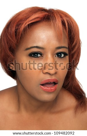 A close-up of a beautiful black woman with red hair.