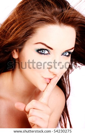 A close up of a beautiful woman telling you to keep quiet!!