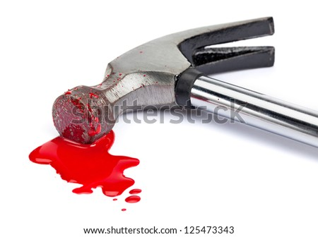 A close-up of a bloody hammer and small blood pool (red paint) isolated on white.