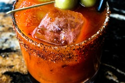 A close-up of a bloody mary type drink or cocktail.