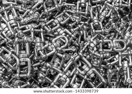 A close up of a box of stainless steel fasteners and clips, ideal for backgrounds in black and white #1433398739