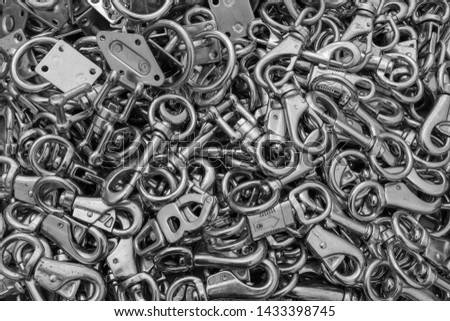 A close up of a box of stainless steel fasteners and clips, ideal for backgrounds in black and white #1433398745