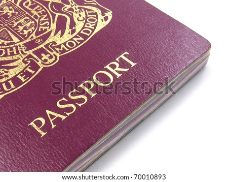 A close up of a British passport on a white background