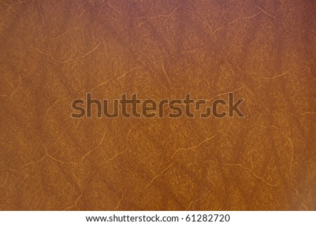 A close up of a brown raw leather