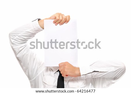 A close-up of a businessman hiding behind a sheet of white paper, alot of space to put text