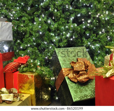 A close-up of a Christmas tree with presents underneath.