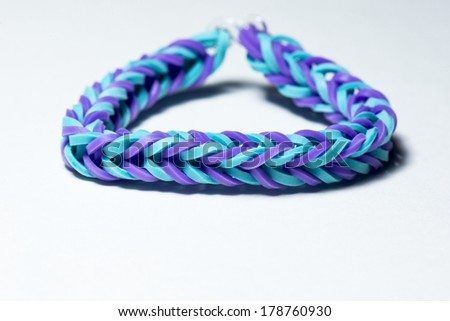 A close up of a colorful rubberband bracelet.
