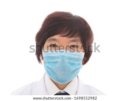 A close-up of a female doctor wearing a mask