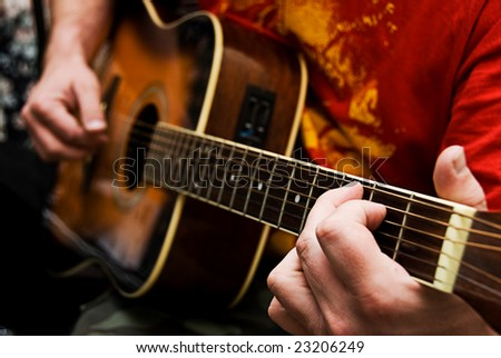 A Close Up Of A Guitarists Hands Playing Acoustic Guitar ...