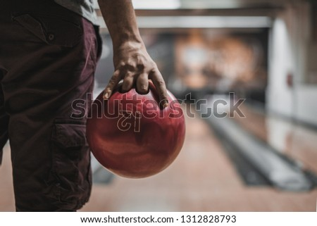 A close-up of a hand with bowling ball  in a bowling alley. Bowling night