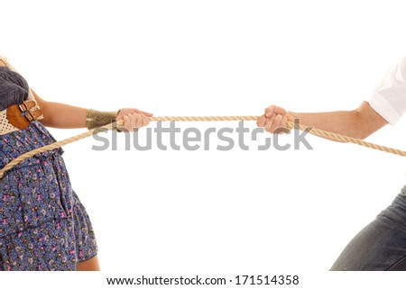 A close up of a man and woman doing a tug of war with a rope.
