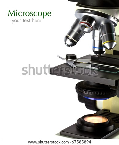 A close-up of a microscope on white background with copy space.