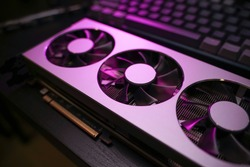 A close up of a modern GPU Graphic card unit heatsink with active fan for thermal solution