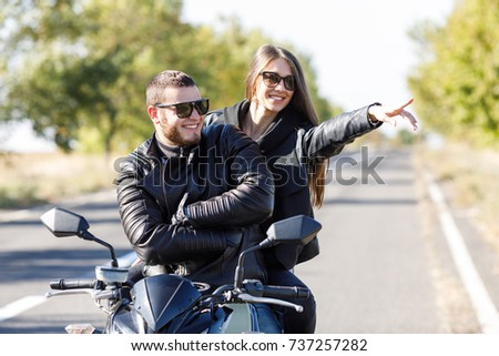 A close-up of a motorcycle stands on the road with its owner alone #737257282