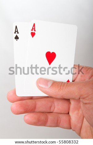 A close up of a pair of aces in playing cards
