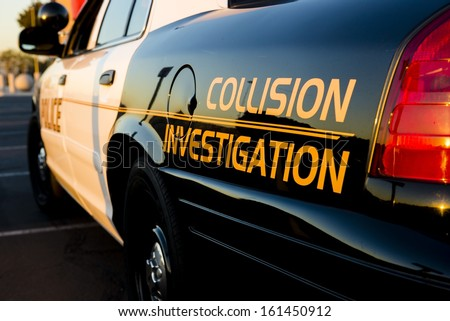 A close up of a police car that investigate traffic collisions.