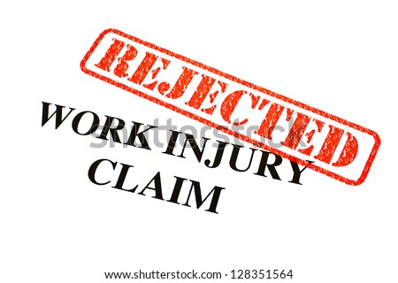 A close-up of a REJECTED Work Injury Claim document.