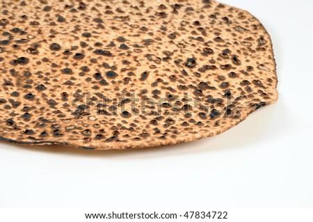 A close up of a round matzoh.