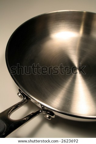 A close up of a stainless steel frying pan.